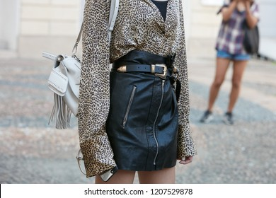 MILAN, ITALY - SEPTEMBER 21, 2018: Woman with leopard pattern skin shirt and black leather skirt before Tods fashion show, Milan Fashion Week street style