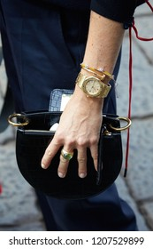 MILAN, ITALY - SEPTEMBER 21, 2018: Woman with golden Audemars Piguet Royal Oak watch and Cartier bracelet before Sportmax fashion show, Milan Fashion Week street style