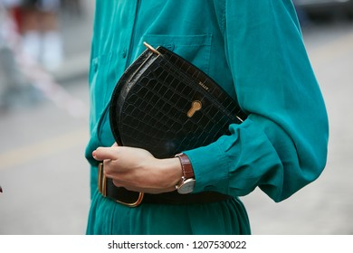 MILAN, ITALY - SEPTEMBER 21, 2018: Woman with Bally black reptile leather bag before Marco de Vincenzo fashion show, Milan Fashion Week street style