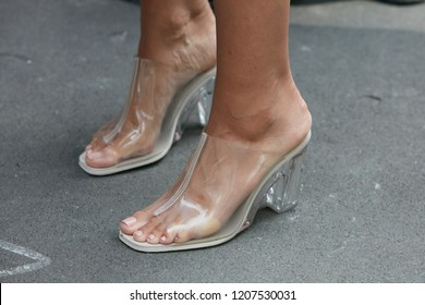 MILAN, ITALY - SEPTEMBER 21, 2018: Woman with transparent high heel shoes before Marco de Vincenzo fashion show, Milan Fashion Week street style
