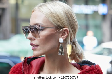 MILAN, ITALY - SEPTEMBER 21, 2018: Woman with transparent Celine sunglasses before Sportmax fashion show, Milan Fashion Week street style
