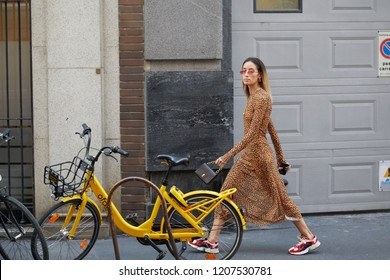 MILAN, ITALY - SEPTEMBER 21, 2018: Woman with leopard skin pattern dress walking before Blumarine fashion show, Milan Fashion Week street style