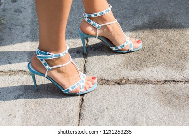 Milan, Italy - September 21, 2018: Model wears a pair of white and blue sandals during the Blumarine fashion show