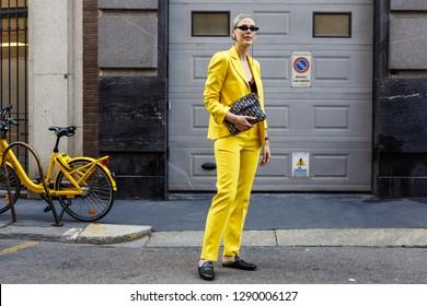 MILAN, ITALY - SEPTEMBER 21, 2018: Sofie Valkiers wearing yellow suit seen outside BLIMARINE show during Milan Fashion Week Spring/Summer 2019.