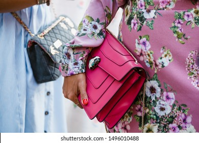 MILAN, ITALY - SEPTEMBER 21, 2018: Fashionable woman holding Bvlgari bag before Blumarine fashion show at Milan Fashion Week Spring/Summer 2019.