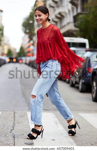 MILAN, ITALY - SEPTEMBER 21, Woman arrives at N°21 fashion show, Milan Fashion Week Spring/Summer 2017