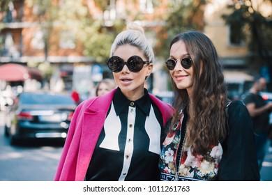 Milan, Italy - September 22, 2017: Fashionable girls on the street during Milan Fashion Week.