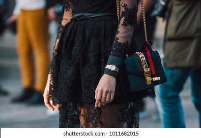 Milan, Italy - September 22, 2017: Girl with a Gucci purse durin Milan Fashion Week shows.