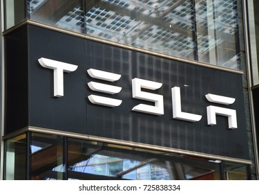 MILAN, ITALY - SEPTEMBER 22, 2017: Tesla signboard store in Piazza Gae Aulenti square in Milan, Italy