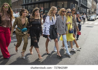 Milan, Italy - September 22, 2017: Beautiful girls in fashionable outfits posing outside a fashion show, during Milan Fashion Week SS2018.