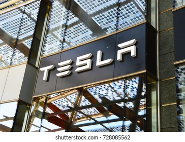 MILAN, ITALY - SEPTEMBER 22, 2017: Tesla sign store in Piazza Gae Aulenti square in Milan, Italy