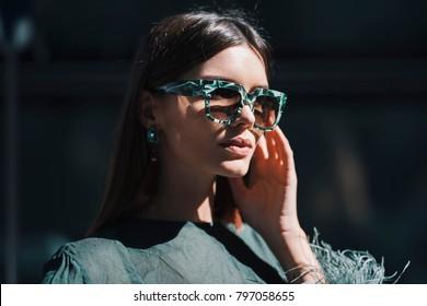 Milan, Italy - September 22, 2017: Fashionable girl portrait during Milano Fashion Week