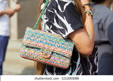 MILAN, ITALY - SEPTEMBER 22, 2018: Woman with Chanel colorful bag and black and white shirt before Philosophy fashion show, Milan Fashion Week street style