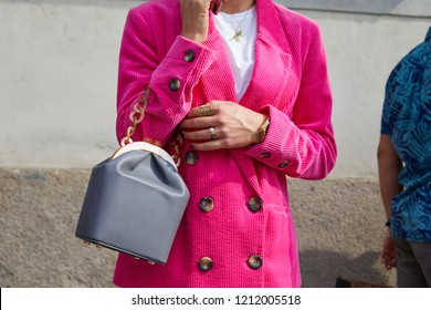 MILAN, ITALY - SEPTEMBER 22, 2018: Woman with pink velvet jacket and gray leather belt before Ermanno Scervino fashion show, Milan Fashion Week street style
