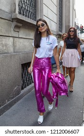 MILAN, ITALY - SEPTEMBER 22, 2018: Woman with pink metallic trousers and white shirt before Ermanno Scervino fashion show, Milan Fashion Week street style