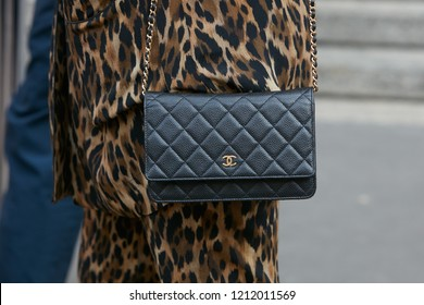 MILAN, ITALY - SEPTEMBER 22, 2018: Woman with black Chanel leather bag before Salvatore Ferragamo fashion show, Milan Fashion Week street style