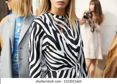 MILAN, ITALY - SEPTEMBER 22, 2018: Woman with black and white zebrine dress before Gabriele Colangelo fashion show, Milan Fashion Week street style