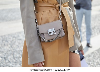 MILAN, ITALY - SEPTEMBER 22, 2018: Woman with gray leather Givenchy bag and beige coat before Gabriele Colangelo fashion show, Milan Fashion Week street style