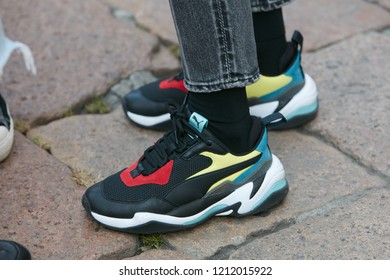 red yellow and blue pumas