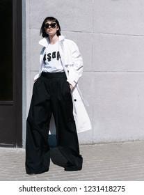Milan, Italy - September 22, 2018: Street style outfits during Milan Fashion Week - - MFWSS19