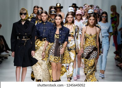 MILAN, ITALY - SEPTEMBER 22: Models walk the runway finale at the Versace show during Milan Fashion Week Spring/Summer 2018 on September 22, 2017 in Milan, Italy.