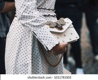 Milan, Italy - September 23, 2017: Woman with a Gucci luxury bag during Milan Fashion Week.