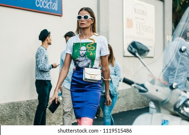 MILAN, ITALY - SEPTEMBER 23, 2017: Fasionable Woman wearing t-shirt with Putin portrait, seen after MISSONI Show at Milan Fashion Week Spring/Summer 2018