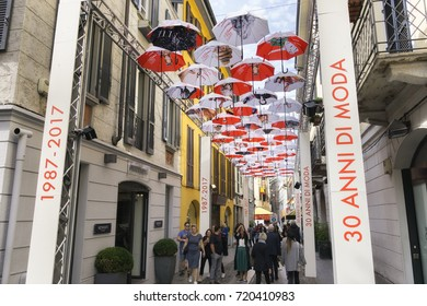 MILAN, ITALY - SEPTEMBER 23, 2017: During Milan Fashion Week 2017 Brera district is decorated with hundreds of umbrellas floating above the street celebrating 30 years of Elle covers