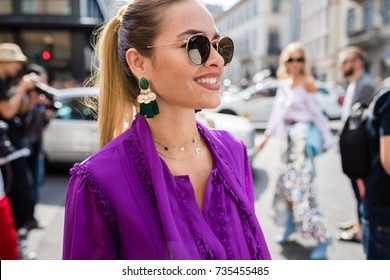 MILAN, ITALY - SEPTEMBER 23, 2017: woman attending fashion show during Milan Fashion Week Women Spring/Summer 2017/2018