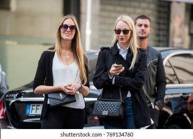 Milan, Italy - September 23, 2017: Beautiful girls outside fashion shows during Milan Fashion Week.