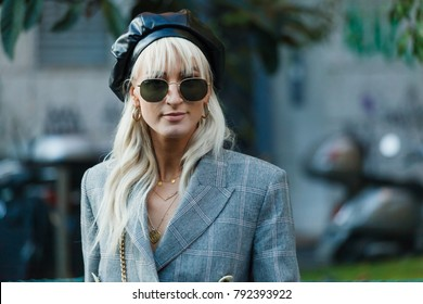 MILAN, ITALY - SEPTEMBER 23, 2017: Fashionable woman poses for photographers before Prada fashion show at Milan Fashion Week Spring/Summer 2018.