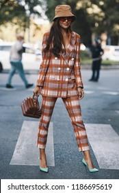 Milan, Italy - September 23, 2018: Street style outfits before Giorgio Armani fashion show during Milan Fashion Week - MFWSS19