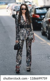 Milan, Italy - September 23, 2018: Street style outfits before Dolce Gabbana fashion show during Milan Fashion Week - - MFWSS19