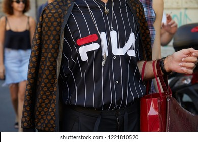 MILAN, ITALY - SEPTEMBER 23, 2018: Man with black and white striped Fila shirt before Fila fashion show, Milan Fashion Week street style