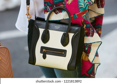 MILAN, ITALY - SEPTEMBER 23, 2018: Woman with black and white Celine leather bag before Giorgio Armani fashion show, Milan Fashion Week street style