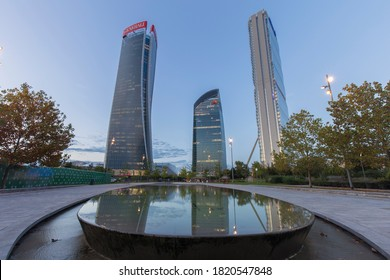 Milan, Italy - September 23, 2020: street view of skyscrapers in piazza Tre Torri during twilight, long exposure makes people quite invisible or blurry.