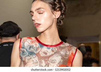 MILAN, ITALY - SEPTEMBER 23: Beautiful model poses in the backstage just before Francesca Liberatore show during Milan Women's Fashion Week on SEPTEMBER 23, 2018 in Milan.
