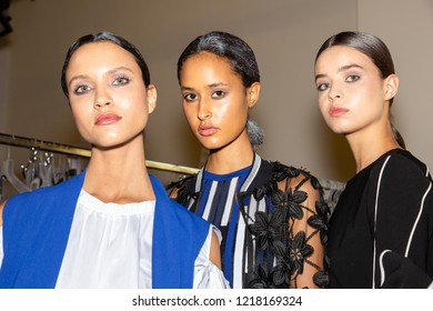 MILAN, ITALY - SEPTEMBER 23: Beautiful models pose in the backstage just before D.Exterior show during Milan Women's Fashion Week on SEPTEMBER 23, 2018 in Milan.