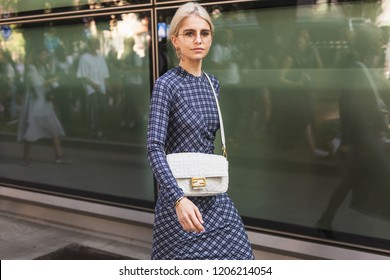 MILAN, ITALY - SEPTEMBER 23: Fashionable woman poses outside Giorgio Armani fashion show during Milan Women's Fashion Week on SEPTEMBER 23, 2018 in Milan.