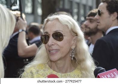 MILAN, ITALY - SEPTEMBER 23: Franca Sozzani speaks to media outside Armani fashion shows building during Milan Women's Fashion Week on September 23, 2013 in Milan, Italy.