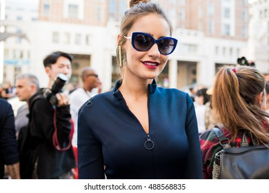 MILAN, ITALY - SEPTEMBER 24, 2016: People, stylists, models, fashion bloggers and photographer in the street during Milan Fashion Week Woman spring/summer 2017