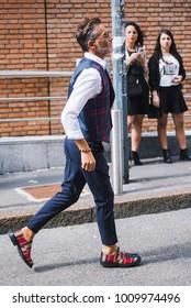 Milan, Italy - September 24, 2017: Men in a fashion outfit posing on the street during Milan Fashion Week.