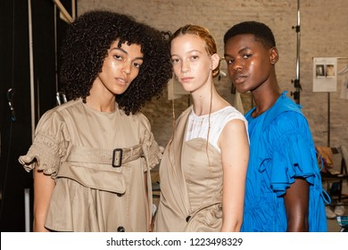 MILAN, ITALY - SEPTEMBER 24: Beautiful models pose in the backstage just before Chika Kisada show during Milan Women's Fashion Week on SEPTEMBER 24, 2018 in Milan.