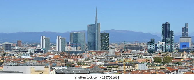 Milan , Italy september 24,2018 Duomo, Vittorio Emanuele gallery and skyline - skyscrapers and downtown - Unicredit tower with mountains behind - Aerial view