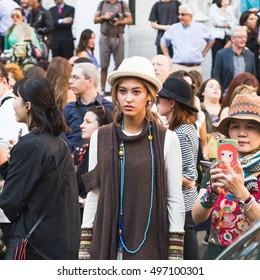 MILAN, ITALY - SEPTEMBER 25, 2016: Fashionable people gather outside Ferragamo fashion show building during Milan Women Fashion Week SS17.