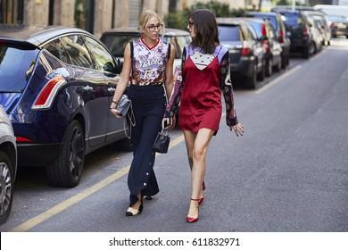 MILAN, ITALY - SEPTEMBER 25, 2016 Women arrive at Dolce & Gabbana fashion show, Milan Fashion Week Spring/Summer 2017