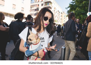 MILAN, ITALY - SEPTEMBER 25: People during Milan Fashion week, Italy on SEPTEMBER 25, 2015. Eccentric, fashionable people waiting models and vips outside during Milan fashion week holding chihuahua