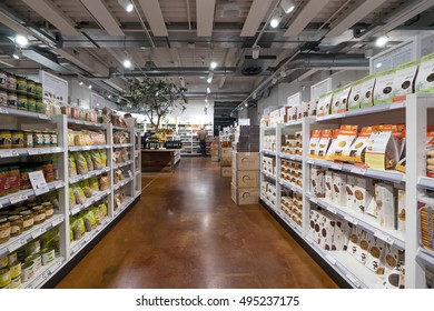 MILAN, ITALY - SEPTEMBER 27, 2016: Shelves inside Eataly store. Eataly is a high-end Italian food market/mall chain founded by Oscar Farinetti in 2004.