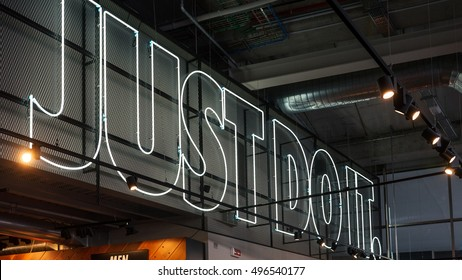 MILAN, ITALY - SEPTEMBER 27, 2016: JUST DO IT inside Nike store. Nike is one of the world's largest suppliers of athletic shoes and apparel. The company was founded on January 25, 1964.