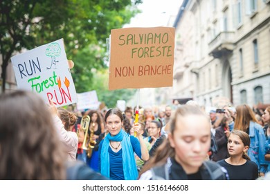 """Milan, Italy – September 27, 2019: students holding picket signs at """"Fridays For Future"""" climate change strike protest  in downtown Milan"""